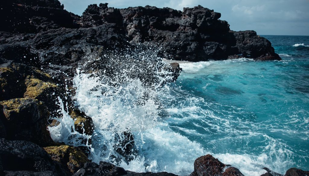 Waves crashing against a cliff face