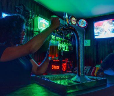 Person filling beer at a bar