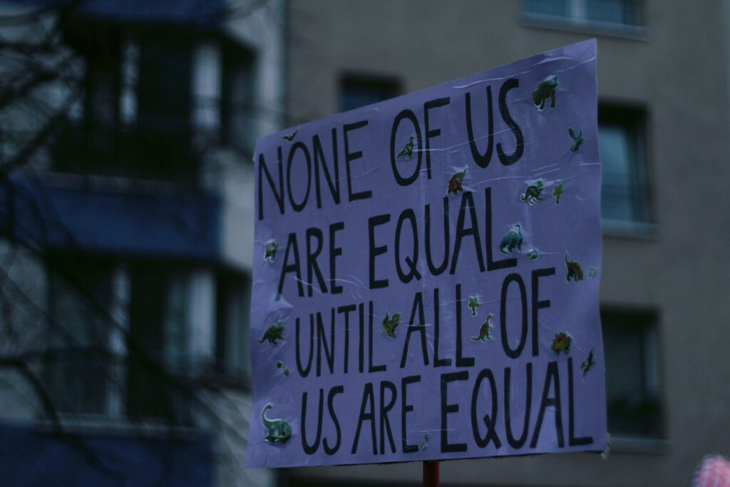 "Sign that says ""None of us are equal until all of us are equal"""
